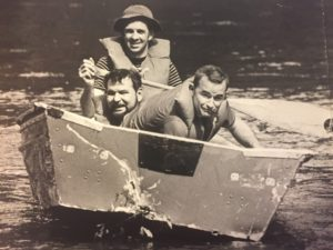 The next we tried to salvage a boat we found pinned against rocks. The Brother Dave, L, me. I don't remember the guy with the paddle.